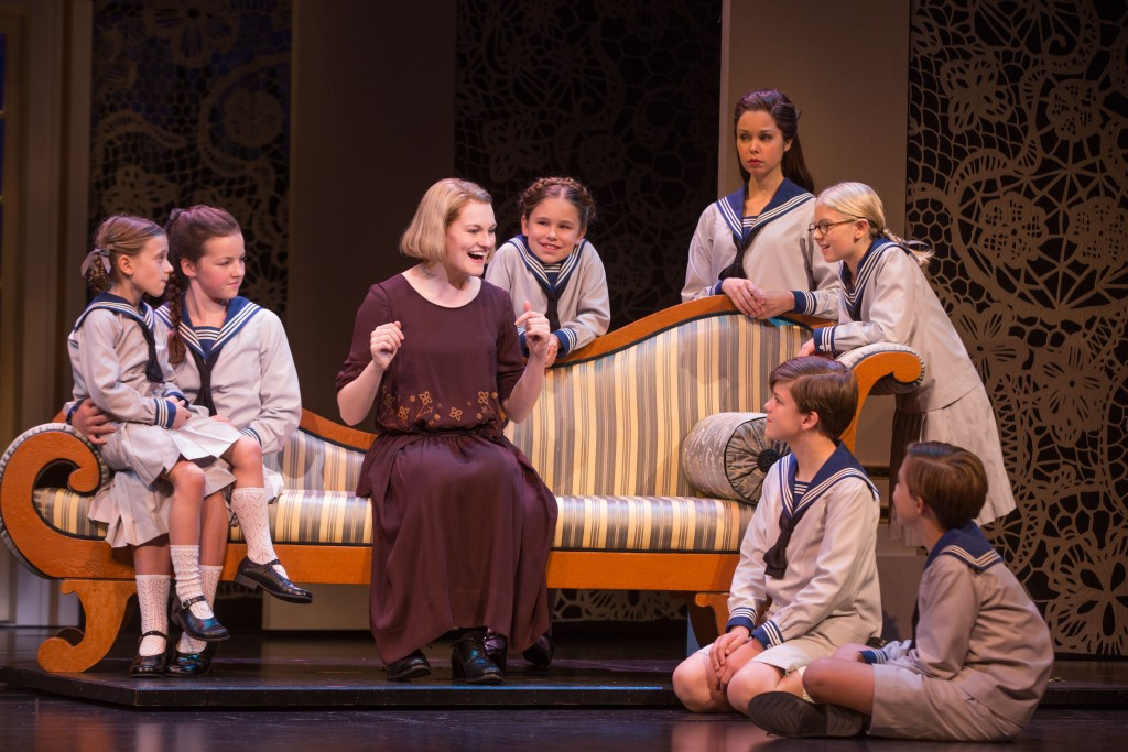 """Kerstin Anderson plays Maria Rainer in the national tour of Rodgers & Hammerstein's """"The Sound of Music,"""" directed by Jack O'Brien. Anderson is joined by the von Trapp children: (From left clockwise) Audrey Bennett, who plays Gretl, Maria Knasel (Louisa), Mackenzie Currie (Marta), Paige Silvester (Liesl), Svea Johnson (Brigitta), Erich Schuett (Friedrich), Quinn Erickson (Kurt). """"The Sound of Music"""" is now playing at the Center Theatre Group/Ahmanson Theatre through October 31, 2015. Tickets are available at CenterTheatreGroup.org or by calling (213) 972-4400. Contact: CTG Media and Communications / (213) 972-7376 / CTGMedia@ctgla.org Photo by Matthew Murphy."""
