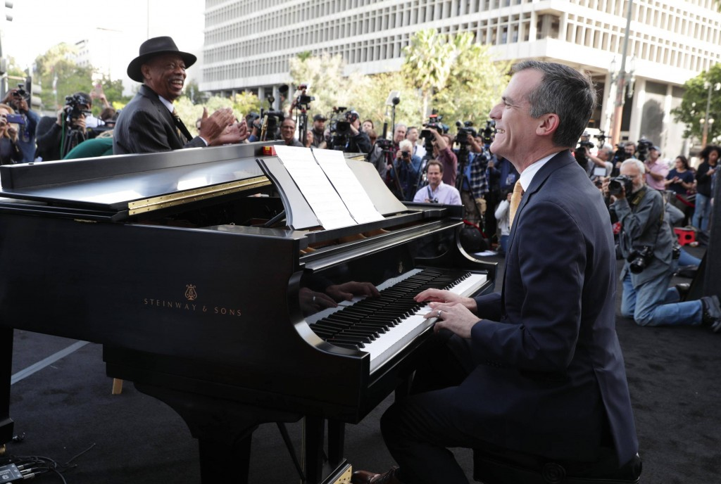 "Los Angeles Mayor Eric Garcetti performs at the ""La La Land Day"" Celebration in Los Angeles City Hall on Tuesday, April 25, 2016, in Los Angeles. (Photo by Eric Charbonneau/Invision for Lionsgate Home Entertainment/AP Images)"