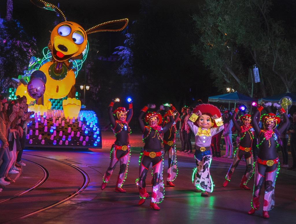 AN ELECTRIC RODEO (ANAHEIM, Calif.) –– Jessie and the Lasso Dancers lead the way for Slinky Dog, Buzz Lightyear and Woody from Disney●Pixar's 'Toy Story' films in this all-new after-dark spectacular at Disneyland park inspired by the iconic 'Main Street Electrical Parade.' 'Paint the Night' is full of vibrant color and more than 1.5 million, brilliant LED lights and features special effects, unforgettable music, and energetic performances that bring beloved Disney and Disney●Pixar stories to life. (Paul HIffmeyer/Disneyland Resort)