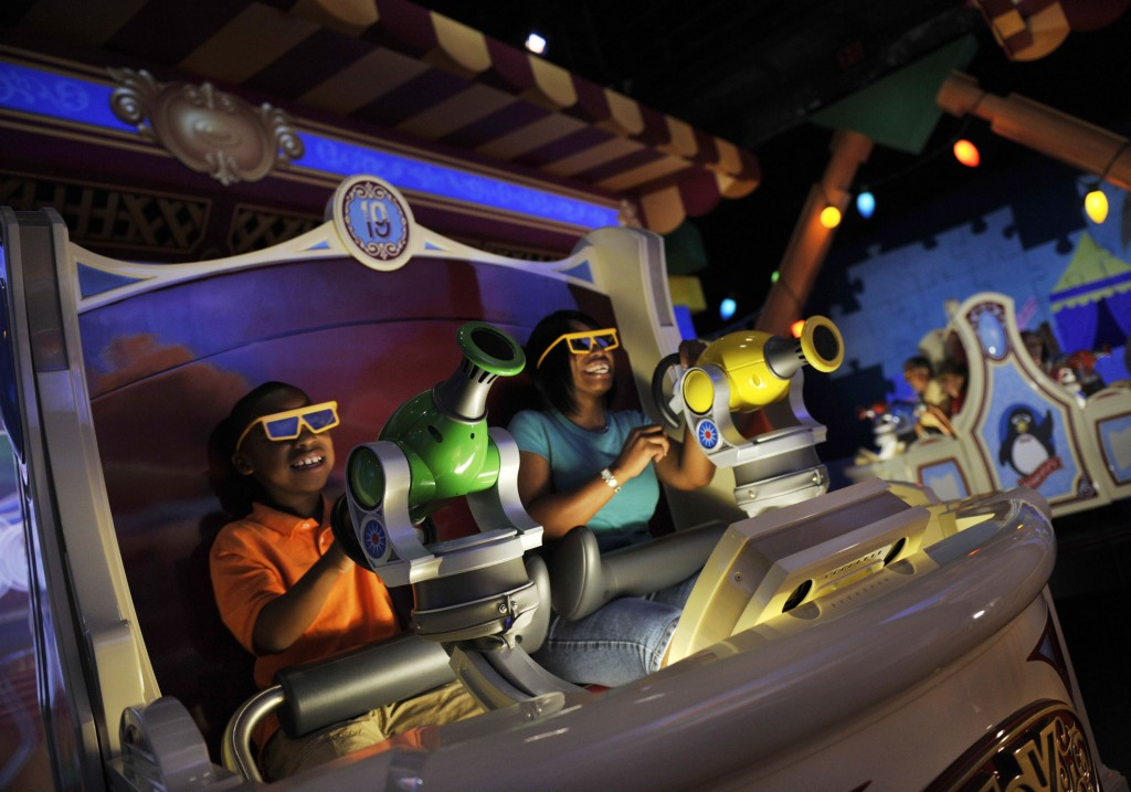 "TOY STORY MANIA -- Donning 3-D glasses and manning ""spring-action shooters,"" Disneyland Resort guests enjoy the new ""Toy Story Mania!"" attraction at Disney's California Adventure in Anaheim, Calif.  The cutting-edge ride-through attraction combines the fun of a video game, 4-D technology and interaction with favorite Disney-Pixar stars. (Gene Duncan/Disneyland)"