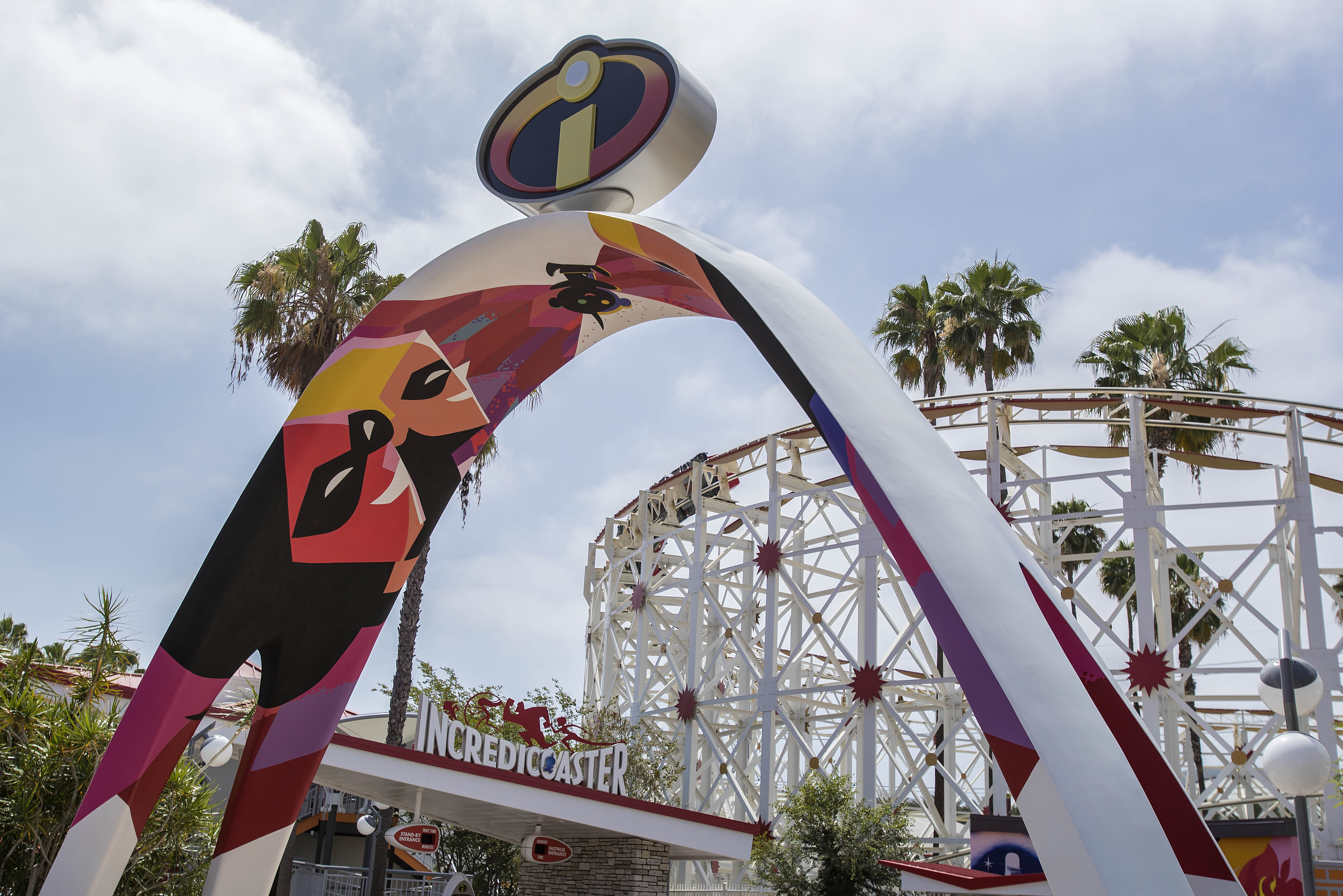 """INCREDIBLES PARK IN PIXAR PIER (ANAHEIM, Calif.) - Inspired by """"The Incredibles"""" and """"Incredibles 2,"""" Incredibles Park features mid-century modern design aesthetics. Guests will enter through an archway where the iconic Incredibles logo will be seen overhead. Once inside, the new Incredicoaster will take guests on a thrilling race alongside the Parr family. Upon exiting the attraction, the Jack-Jack Cookie Num Nums stand will tempt guests with freshly-baked treats. (Joshua Sudock/Disneyland Resort)"""