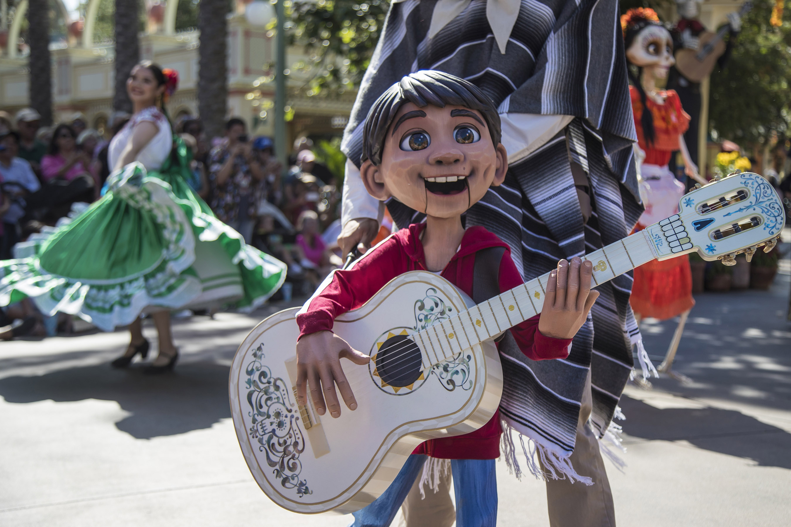 "PLAZA DE LA FAMILIA AT DISNEY CALIFORNIA ADVENTURE PARK (ANAHEIM, Calif.) – Plaza de la Familia, a limited-time festivity at Paradise Gardens, celebrates Disney•Pixar's Academy Award®-winning film ""Coco"" and the everlasting bonds of family. Guests visiting Plaza de la Familia will enjoy an immersive celebration that includes live entertainment with storytelling, folklórico dancers and mariachi musicians, delicious Mexican fare and interactive experiences such as the new craft where guests make colorful masks like the ones seen in the ""Coco"" film. This celebration runs from Sept. 7 through Nov. 4, 2018 at Disney California Adventure Park. (Joshua Sudock/ Disneyland)"