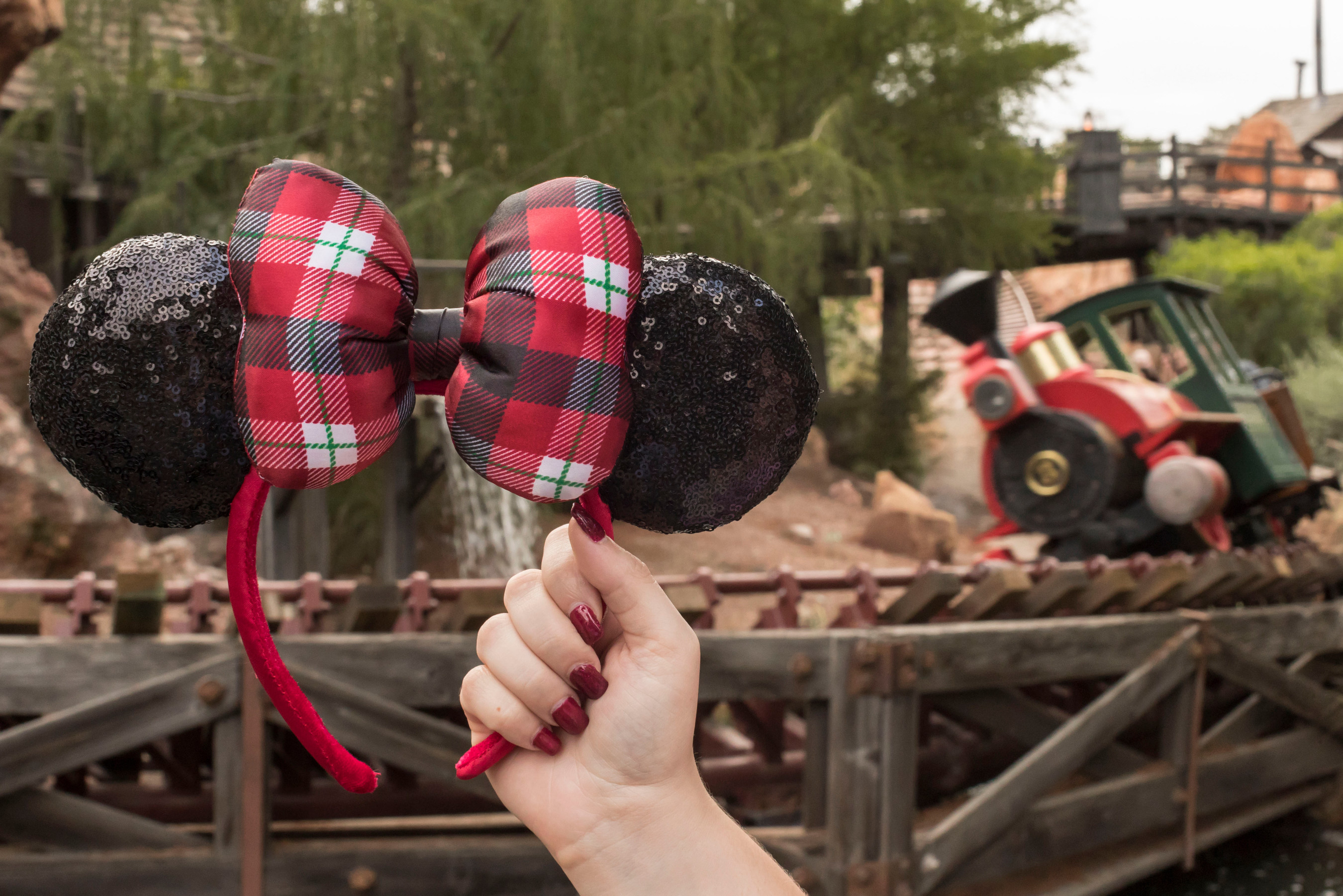 This pair of Minnie Mouse Plaid Bow Ears featuring sequin details is one of the three seasonal Minnie Ears designs found throughout Disneyland Resort in California and Walt Disney World Resort in Florida during the holiday season. (Joshua Sudock/Disneyland Resort)