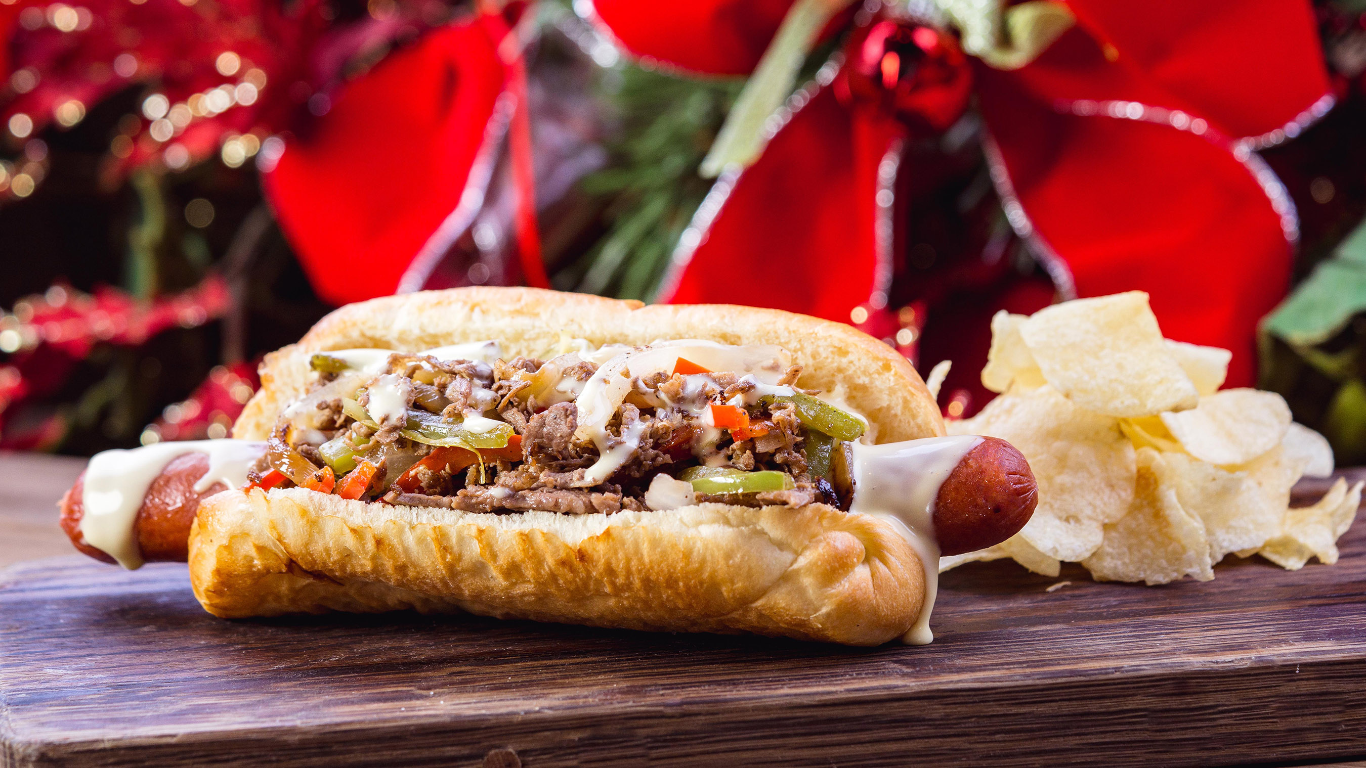 The Philly cheesesteak dog can be found for a limited time at Refreshment Corner on Main Street, U.S.A. at Disneyland park during Holidays at the Disneyland Resort. It's just one of many specialty food items available throughout the resort during the 2018-2019 holiday season. Disneyland Resort is located in Anaheim, Calif. (Disneyland Resort)